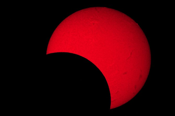 "hursday afternoon, the moon will sideswipe the sun, creating a partial solar eclipse like the one shown in this image taken May 20, 2012. At maximum eclipse at about 4:35 p.m., 55 percent of the sun will be covered up by the moon. Warning: Never look directly at the sun without a proper solar filter, or permanent eye damage can result. The SKY Club at Colorado Mountain College will host a public ""Solar Eclipse Watch"" with safe solar telescopes set up for public viewing Thursday afternoon on the CMC campus."